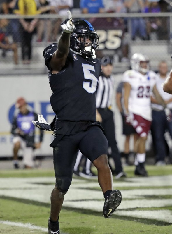 Central Florida wide receiver Dredrick Snelson celebrates after scoring a touchdown against Temple on a 19-yard reception during the first half of an NCAA college football game Thursday, Nov. 1, 2018, in Orlando, Fla. (AP Photo/John Raoux)