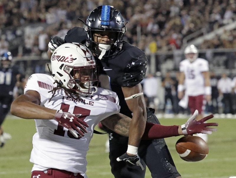 Central Florida defensive back Rashard Causey, right, breaks up a pass intended for Temple wide receiver Isaiah Wright during the first half of an NCAA college football game Thursday, Nov. 1, 2018, in Orlando, Fla. (AP Photo/John Raoux)