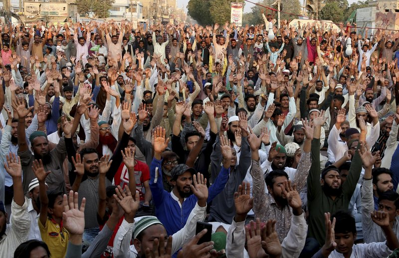 For a second day, protesters rally to condemn a Supreme Court decision that acquitted Asia Bibi, a Christian woman, who spent eight years on death row accused of blasphemy, in Karachi, Pakistan, Thursday, Nov. 1, 2018. Bibi plans to leave the country, her family said Thursday, as Islamists mounted rallies demanding Bibi be publicly hanged and also called for the killing of the three judges, including Chief Justice Mian Saqib Nisar, who acquitted Bibi. (AP Photo/Shakil Adil)