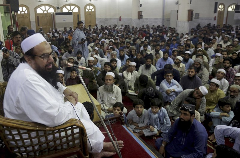 Pakistani cleric Hafiz Saeed, the founder of the outlawed Lashkar-e-Taiba group, which was blamed for the 2008 Mumbai attacks that killed 166 people, addresses at a mosque in Lahore, Pakistan, Thursday, Nov. 1, 2018. Saeed, a radical cleric wanted by the United States, urged followers to hold rallies across Pakistan on Friday to condemn the Supreme Court decision that acquitted Asia Bibi, a Christian woman, who spent eight years on death row accused of blasphemy. Meanwhile, opposition lawmakers in parliament called Thursday for reforming the judicial system and Pakistan's controversial blasphemy law — so that innocents like Bibi wouldn't spent years languishing in jail. (AP Photo/K.M. Chaudary)