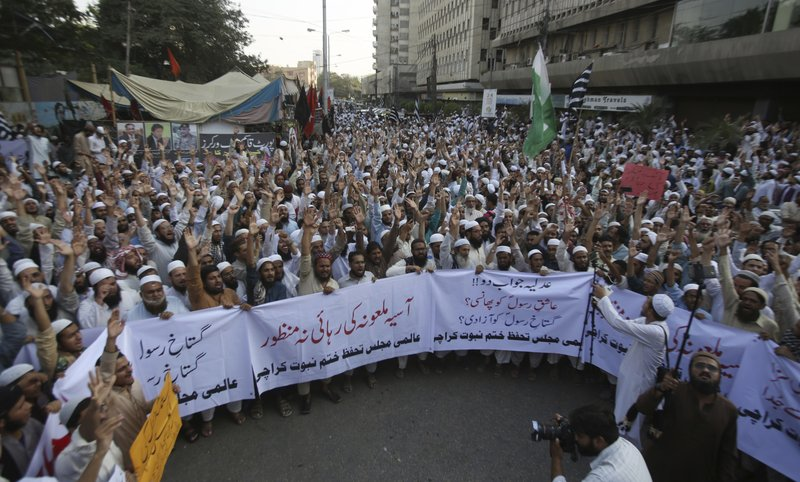 For a second day, radical Islamists rally to condemn a Supreme Court decision that acquitted Asia Bibi, a Christian woman, who spent eight years on death row accused of blasphemy, in Karachi, Pakistan, Thursday, Nov. 1, 2018. Bibi plans to leave the country, her family said Thursday, as Islamists mounted rallies demanding Bibi be publicly hanged. The Islamists also called for the killing of the three judges, including Chief Justice Mian Saqib Nisar, who acquitted Bibi. Banner reads