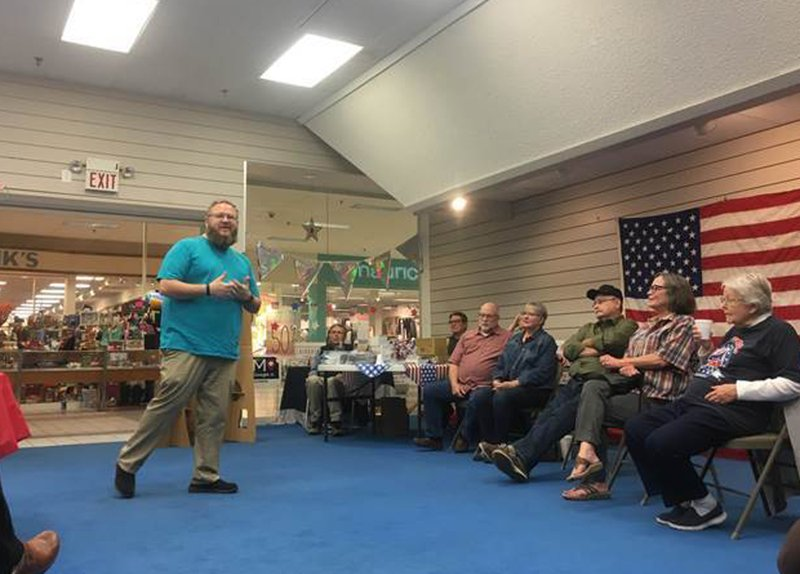 FILE - In this Monday, Oct. 22, 2018, file photo, Ford County Democratic Party chairman Johnny Dunlap speaks about the party's get-out-the-vote efforts during a meeting of volunteers in Dodge City, Kan. An election official's unilateral decision to move the sole polling site in Dodge City to a more inaccessible location outside of town imposes a severe burden on all voters, but disproportionately impacts Hispanic voters who are less likely to have access to transportation and lack flexible work schedules, according to a federal lawsuit filed in October 2018. (Jonathan Shorman/The Wichita Eagle via AP)