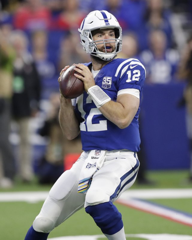 FILE - In this Oct. 21, 2018, file photo, Indianapolis Colts quarterback Andrew Luck looks for a receiver during the first half of the team's NFL football game against the Buffalo Bills in Indianapolis.  Luck has thrown for 23 touchdowns, second only to Kansas City's Patrick Mahomes, who has tremendous talent at wideout and running back to work with. Luck is moving well and, most significantly, his arm strength is excellent. (AP Photo/Michael Conroy, File)