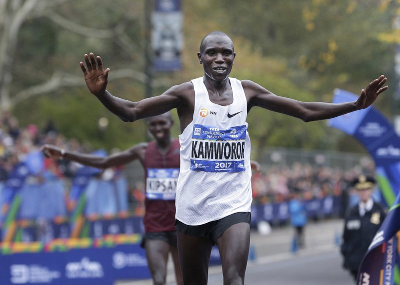 FILE - In this Nov. 5, 2017, file photo, Geoffrey Kamworor, of Kenya, crosses the finish line first to win the men's division of the New York City Marathon in New York. Kamworor earned his first major marathon win in New York last year. (AP Photo/Seth Wenig, File)