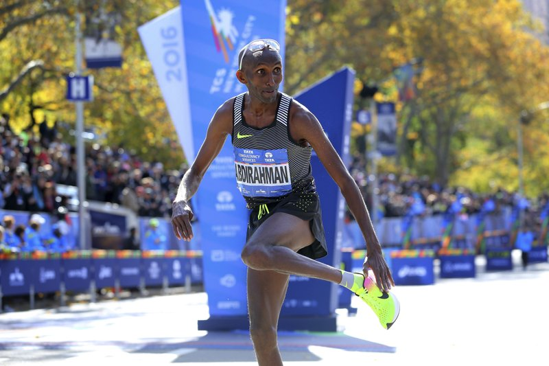 FILE - In this Nov. 6, 2016, file photo, Abdi Abdirahman, of the United States, reacts after crossing the finish line for third place in the men's division at the New York City Marathon in New York. The American men chasing Geoffrey Kamworor at the New York City marathon on Sunday include Abdi Abdirahman and Bernard Lagat. (AP Photo/Seth Wenig, File)