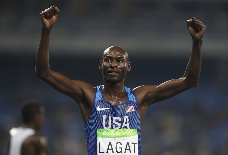 FILE- In this Aug. 20, 2016, file photo, United States' Bernard Lagat celebrates finishing the men's 5000-meter race during the athletics competition at the Summer Olympics in Rio de Janeiro, Brazil. The American men chasing Geoffrey Kamworor at the New York City marathon on Sunday include Abdi Abdirahman and Bernard Lagat. (AP Photo/Lee Jin-man, File)
