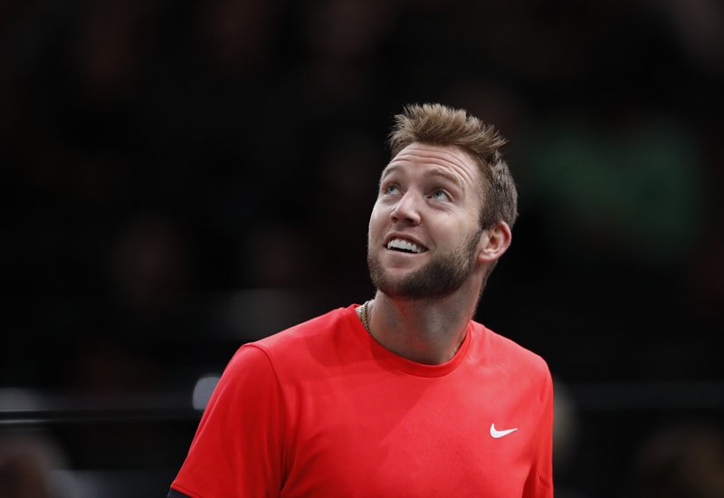 Jack Sock of the U.S. smiles as he plays against Austria's Dominic Thiem during their quarter-final match of the Paris Masters tennis tournament at the Bercy Arena in Paris, France, Friday, Nov. 2, 2018. (AP Photo/Christophe Ena)