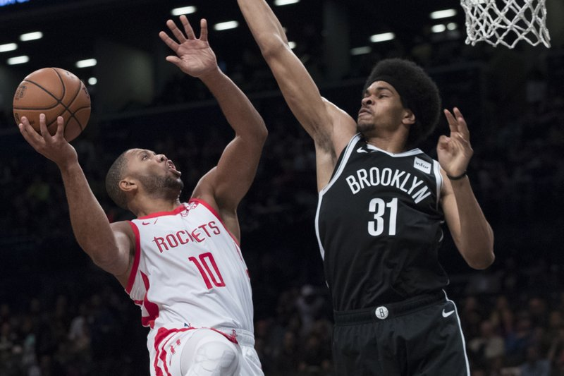 Houston Rockets guard Eric Gordon (10) goes to the basket against Brooklyn Nets center Jarrett Allen (31) during the first half of an NBA basketball game, Friday, Nov. 2, 2018, in New York. (AP Photo/Mary Altaffer)