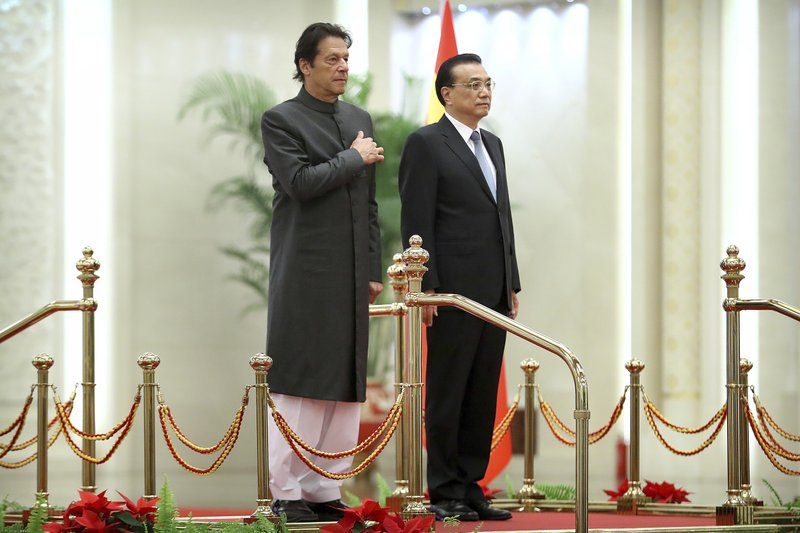 Pakistan's Prime Minister Imran Khan, left, and Chinese Premier Li Keqiang stand together during a welcome ceremony at the Great Hall of the People in Beijing, Saturday, Nov. 3, 2018. (AP Photo/Mark Schiefelbein)