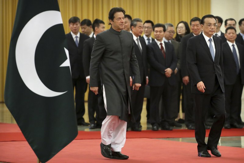 Pakistan's Prime Minister Imran Khan, left, and Chinese Premier Li Keqiang walk together during a welcome ceremony at the Great Hall of the People in Beijing, Saturday, Nov. 3, 2018. (AP Photo/Mark Schiefelbein)