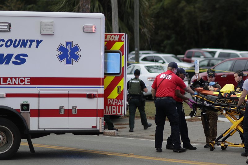 A person is transported from scene of a shooting, Friday, Nov. 2, 2018, in Tallahassee, Fla. A shooter killed one person and critically wounded four others at a yoga studio in Florida's capital before killing himself Friday, officials said. (Tori Schneider/Tallahassee Democrat via AP)