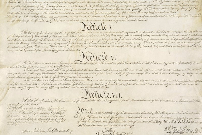 This photo made available by the U.S. National Archives shows a portion of the United States Constitution with Articles V-VII. For the past two centuries, constitutional amendments have originated in Congress, where they need the support of two-thirds of both houses, and then the approval of at least three-quarters of the states. But under a never-used second prong of Article V, amendments can originate in the states. (National Archives via AP)