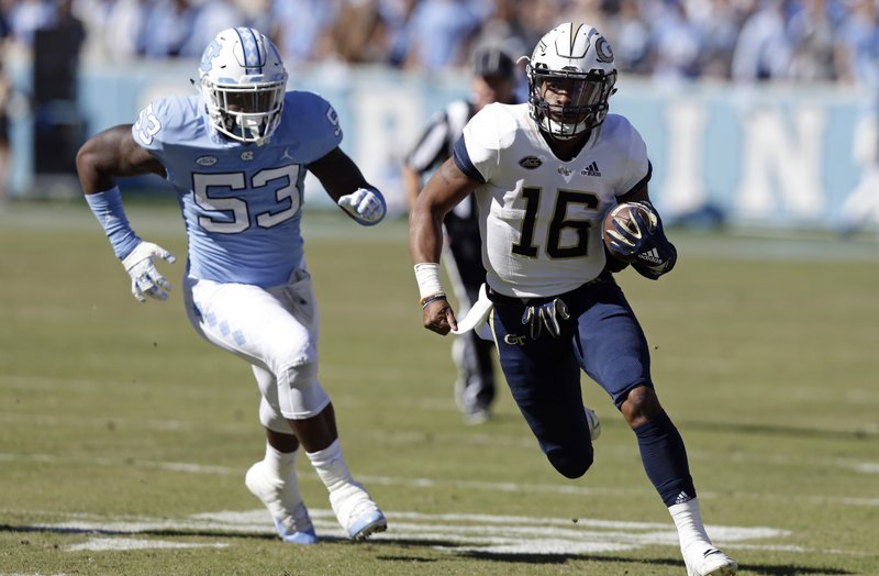 North Carolina's Malik Carney (53) chases Georgia Tech quarterback TaQuon Marshall (16) during the first half of an NCAA college football game in Chapel Hill, N.C., Saturday, Nov. 3, 2018. (AP Photo/Gerry Broome)