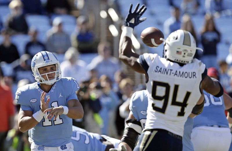 North Carolina quarterback Nathan Elliott (11) has a pass blocked by Georgia Tech's Anree Saint-Amour (94) during the first half of an NCAA college football game in Chapel Hill, N.C., Saturday, Nov. 3, 2018. (AP Photo/Gerry Broome)