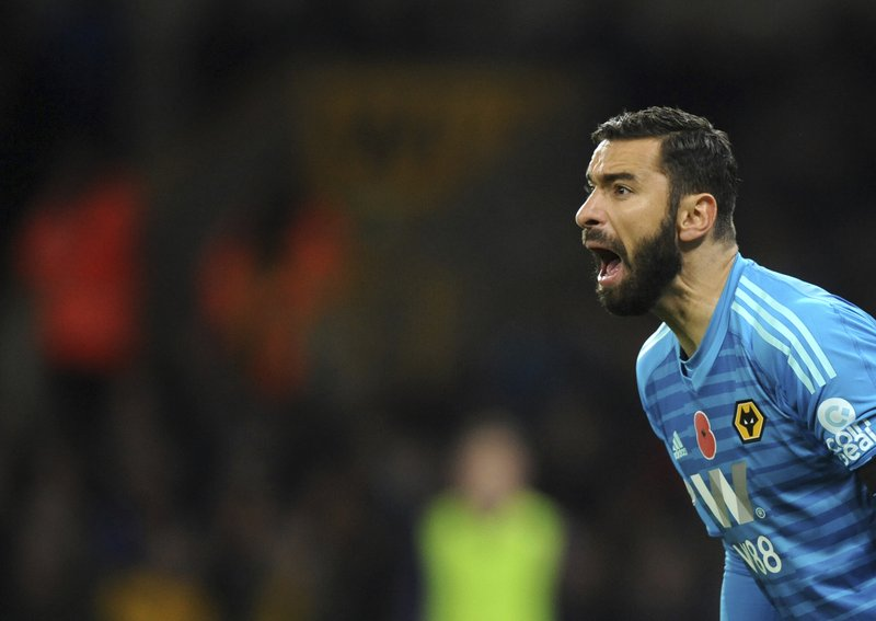 Wolverhampton's Rui Patricio gives instructions to his players during the English Premier League soccer match between Wolverhampton Wanderers and Tottenham Hotspur at the Molineux Stadium in Wolverhampton, England, Saturday, Nov. 3, 2018. (AP Photo/Rui Vieira)