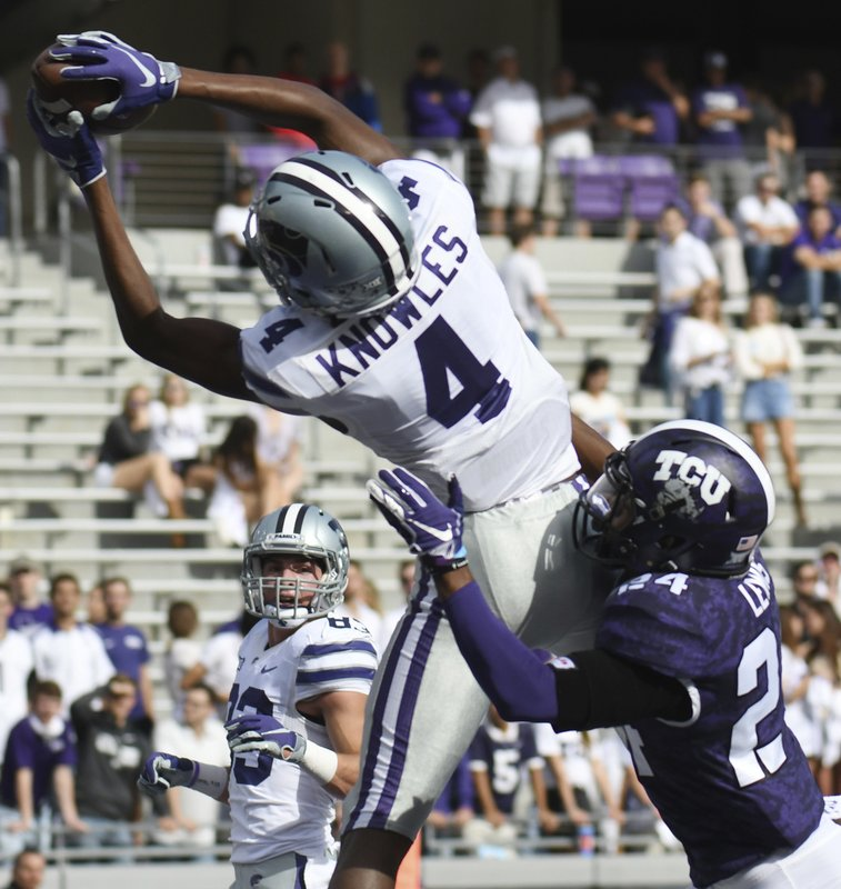 Kansas State's Malik Knowles, top, brings down a catch over TCU's Julius Lewis for the touchdown in the second quarter of an NCAA college football game, Saturday, Nov. 3, 2018, in Fort Worth, Texas. (Bob Haynes/Star-Telegram via AP)