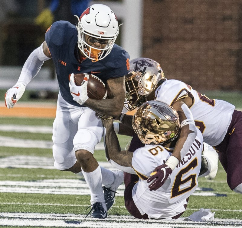 Illinois wide receiver Dominic Stampley (6) is tackled after making a catch in the second half of a NCAA college football game against Minnesota, Saturday, Nov. 3, 2018, in Champaign, Ill. (AP Photo/Holly Hart)