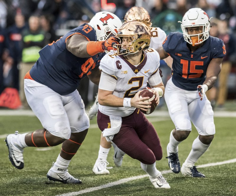Minnesota quarterback Tanner Morgan (2) is grabbed on the face mask by Illinois' Calvin Avery (93) in the second half of a NCAA college football game, Saturday, Nov. 3, 2018, in Champaign, Ill. (AP Photo/Holly Hart)