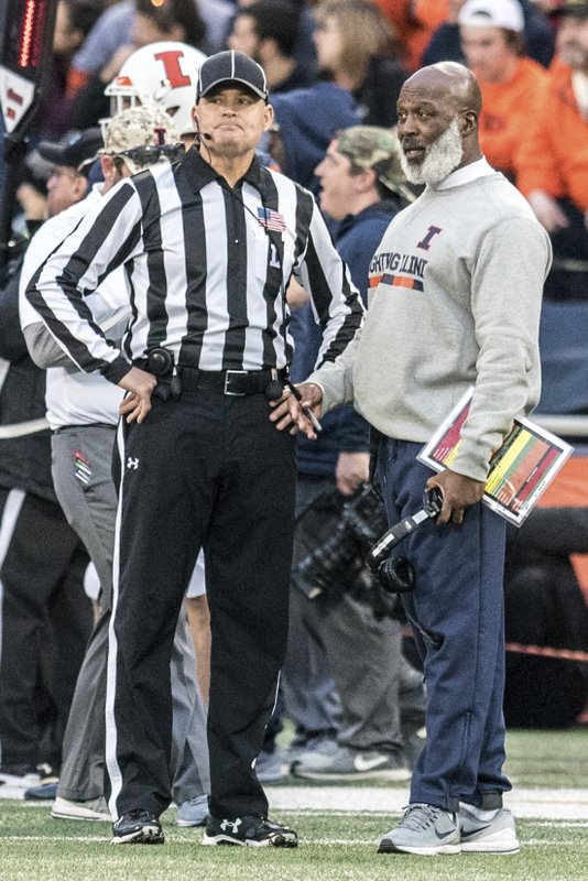 Illinois' Head Coach Lovie Smith has a talk with an official in the second half of a NCAA college football game against Minnesota, Saturday, Nov. 3, 2018, in Champaign, Ill. (AP Photo/Holly Hart)