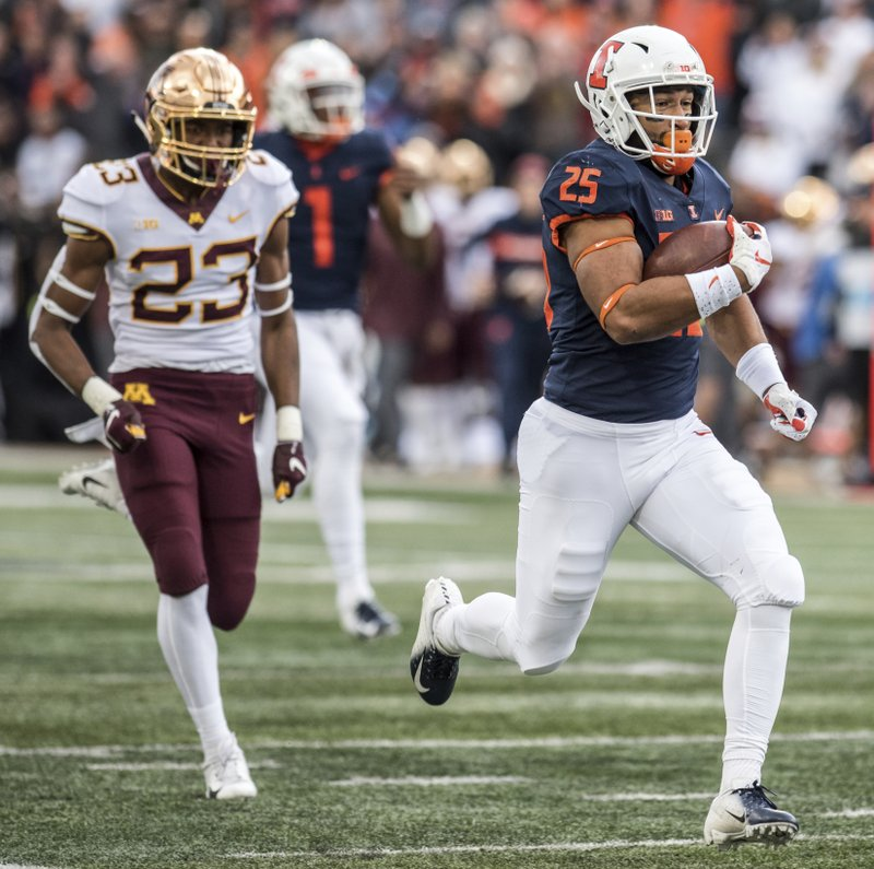 Illinois running back Dre Brown (25) takes the ball to the end zone as Minnesota's Jordan Howden (23)defends in the first half of an NCAA  college football game, Saturday, Nov. 3, 2018, in Champaign, Ill. (AP Photo/Holly Hart)