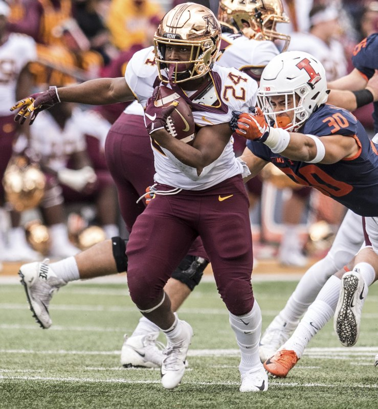 Minnesota running back Mohamed Ibrahim (24) runs as Illinois' Sydney Brown (30) tries to bring him down in the first half of an NCAA  college football game, Saturday, Nov. 3, 2018, in Champaign, Ill. (AP Photo/Holly Hart)