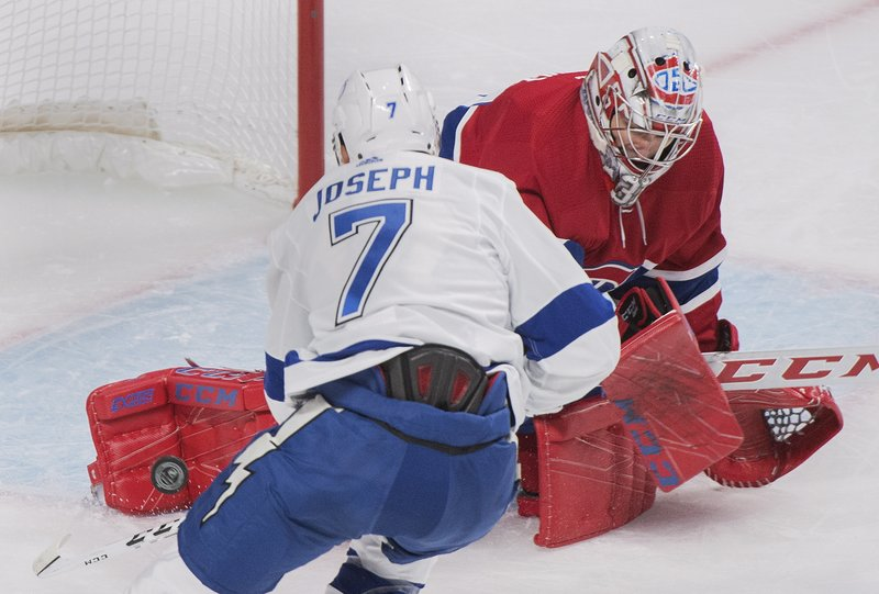 Montreal Canadiens goaltender Carey Price makes a save against Tampa Bay Lightning's Mathieu Joseph during the second period of an NHL hockey game Saturday, Nov. 3, 2018, in Montreal. (Graham Hughes/The Canadian Press via AP)