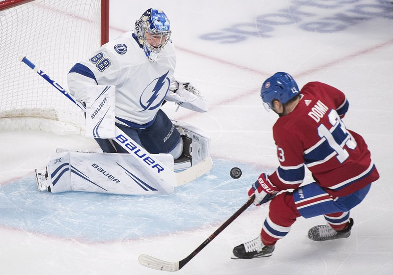 Montreal Canadiens' Max Domi moves in on Tampa Bay Lightning goaltender Andrei Vasilevskiy during the first period of an NHL hockey game Saturday, Nov. 3, 2018, in Montreal. (Graham Hughes/The Canadian Press via AP)