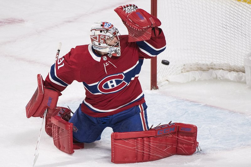 Montreal Canadiens goaltender Carey Price gives up a goal to Tampa Bay Lightning's J.T. Miller during the first period of an NHL hockey game Saturday, Nov. 3, 2018, in Montreal. (Graham Hughes/The Canadian Press via AP)