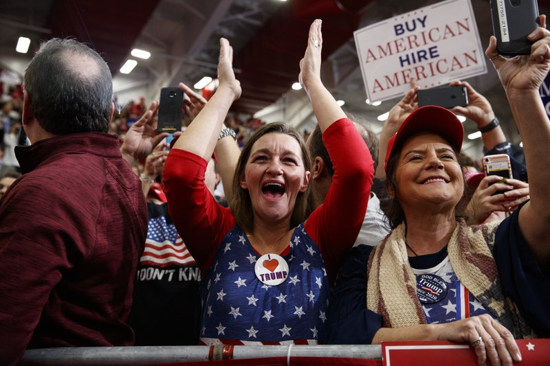 Supporters of President Donald Trump cheer as he arrives for a campaign rally at Southport High School, Friday, Nov. 2, 2018, in Indianapolis. (AP Photo/Evan Vucci)