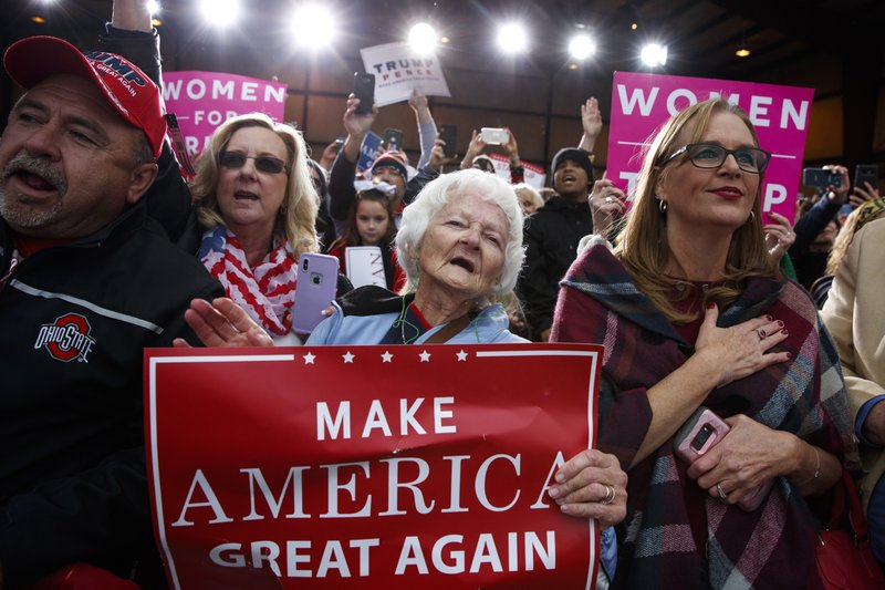 Supporters of President Donald Trump cheer as he arrives to speak at a campaign rally at Huntington Tri-State Airport, Friday, Nov. 2, 2018, in Huntington, W.Va. (AP Photo/Evan Vucci)