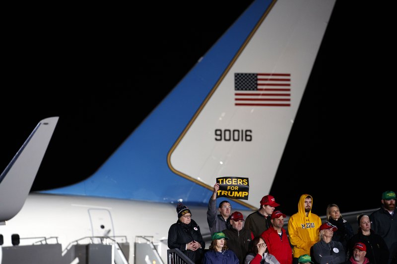 Supporters of President Donald Trump listen to him speak during a campaign rally at Columbia Regional Airport, Thursday, Nov. 1, 2018, in Columbia, Mo. (AP Photo/Evan Vucci)