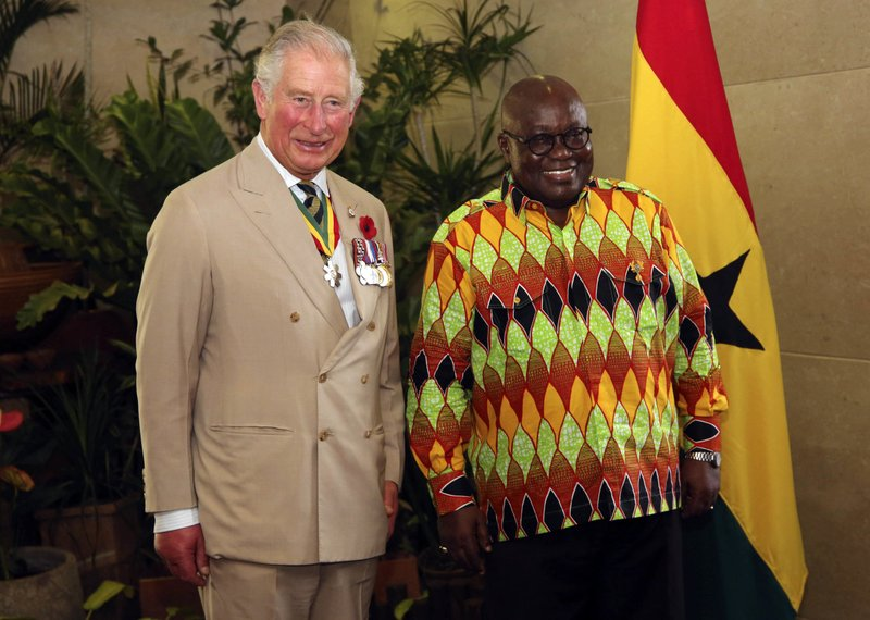 Prince Charles, left, is welcomeb by Ghana's President, Nana Akufo-Addo at the Jubilee House in Accra, Ghana, Friday, Nov. 2, 2018. Prince Charles and his wife Camilla, the Duchess of Cornwall, have arrived in Ghana for the second stop of their West African tour.(AP Photo)