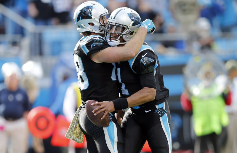 Carolina Panthers' Greg Olsen, left, and Cam Newton, right, celebrates their touchdown against the Tampa Bay Buccaneers in the first half of an NFL football game in Charlotte, N.C., Sunday, Nov. 4, 2018. (AP Photo/Nell Redmond)