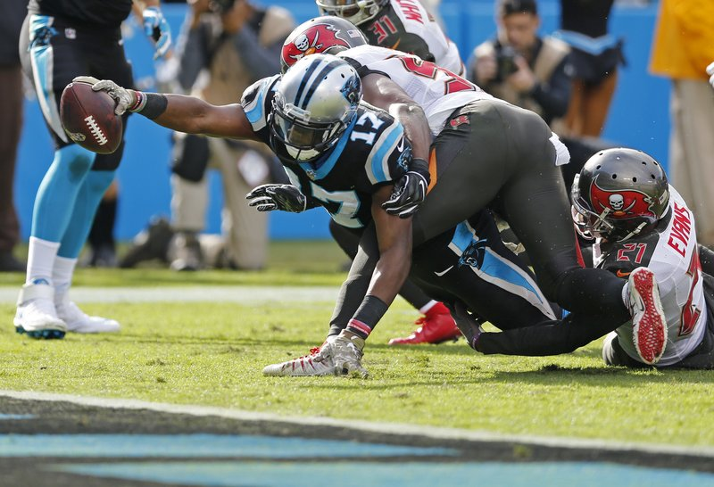 Carolina Panthers' Devin Funchess (17) stretches in vain as Tampa Bay Buccaneers' Justin Evans (21) defends in the first half of an NFL football game in Charlotte, N.C., Sunday, Nov. 4, 2018. (AP Photo/Nell Redmond)