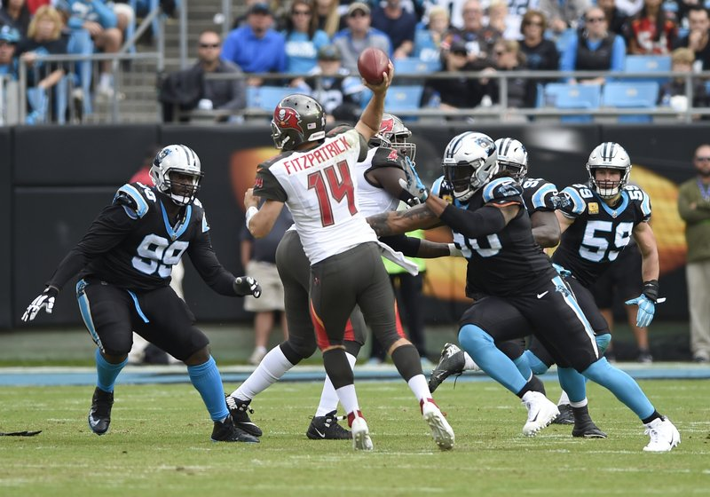 Tampa Bay Buccaneers' Ryan Fitzpatrick (14) tries to throw a pass under pressure from Carolina Panthers' Julius Peppers (90) in the first half of an NFL football game in Charlotte, N.C., Sunday, Nov. 4, 2018. (AP Photo/Mike McCarn)