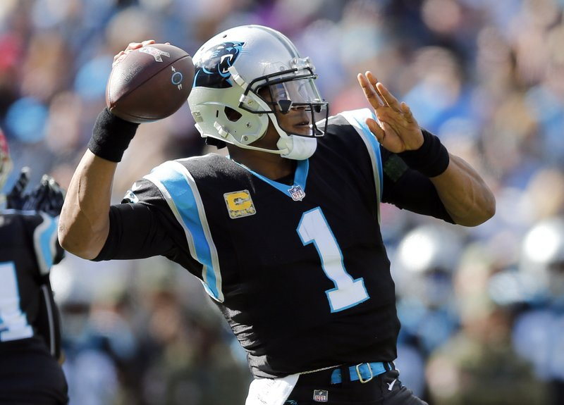 Carolina Panthers' Cam Newton (1) looks to pass against the Tampa Bay Buccaneers in the first half of an NFL football game in Charlotte, N.C., Sunday, Nov. 4, 2018. (AP Photo/Nell Redmond)