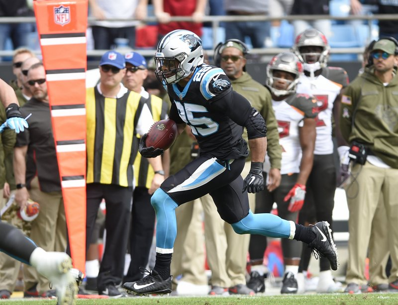 Carolina Panthers' Eric Reid (25) returns an interception against the Tampa Bay Buccaneers in the first half of an NFL football game in Charlotte, N.C., Sunday, Nov. 4, 2018. (AP Photo/Mike McCarn)