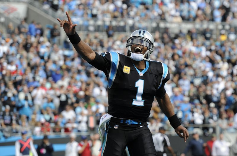 Carolina Panthers' Cam Newton (1) celebrates a Panthers touchdown against the Tampa Bay Buccaneers in the first half of an NFL football game in Charlotte, N.C., Sunday, Nov. 4, 2018. (AP Photo/Mike McCarn)