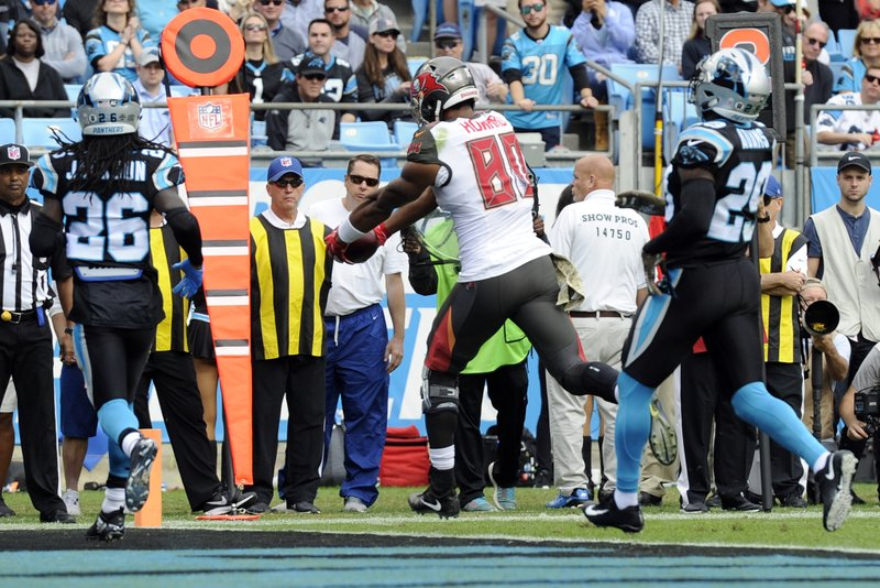 Tampa Bay Buccaneers' O.J. Howard (80) runs past Carolina Panthers' Donte Jackson (26) for a touchdown in the first half of an NFL football game in Charlotte, N.C., Sunday, Nov. 4, 2018. (AP Photo/Mike McCarn)