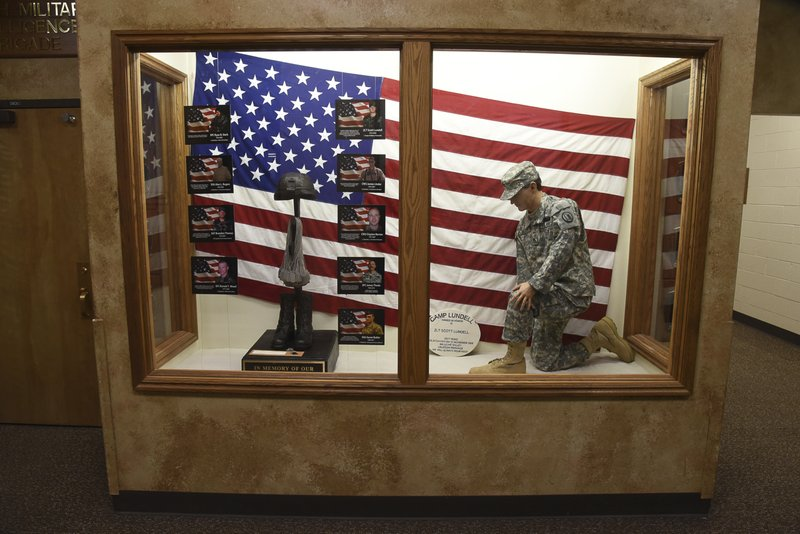The Fallen Soldier Tribute is shown at the Utah Army National Guard Recruiting building Sunday, Nov. 4, 2018, in Draper, Utah. Military officials say a major in Utah's Army National Guard who was also the mayor of a city north of Salt Lake City was killed in Afghanistan after being shot by a member of the Afghan security forces. They say North Ogden Mayor Brent Taylor was in the country to train Afghan commandos and was shot Saturday, Nov. 3, 2018, by one of the trainees at the Kabul military training center. The attacker was then killed by Afghan forces. (Francisco Kjolseth/The Salt Lake Tribune, via AP)