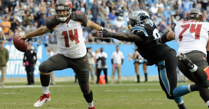 0fc2c736 Tampa Bay Buccaneers' Ryan Fitzpatrick (14) runs past Carolina Panthers'  Kyle Love (93) in the first half of an NFL football game in Charlotte,  N.C., ...