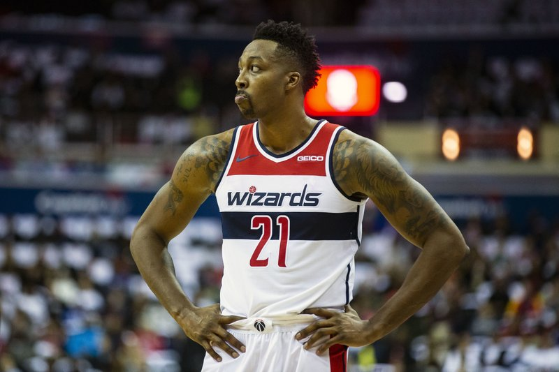 Washington Wizards center Dwight Howard (21) waits as a free throw shot is made during the first half of an NBA basketball game against the New York Knicks, Sunday, Nov. 4, 2018, in Washington. (AP Photo/Al Drago)