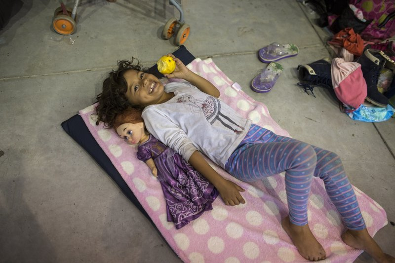 "A girl relaxes next to her doll inside a temporary shelter set up for a splinter group of a migrant caravan hoping to reach the U.S. border, in Cordoba, Veracruz state, Mexico, Sunday, Nov. 4, 2018. Thousands of wary Central American migrants resumed their push toward the United States on Sunday, entering a treacherous part of the caravan's journey on a trek through one of Mexico's deadliest states, along what some called the ""route of death"" toward the town of Cordoba, Veracruz. (AP Photo/Rodrigo Abd)"