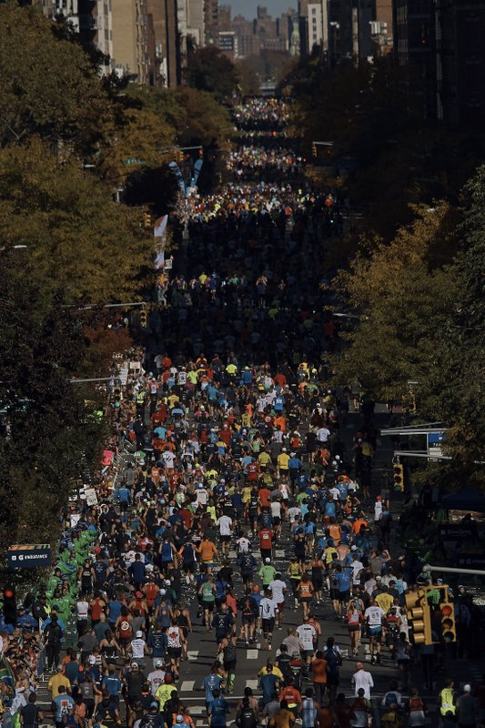Runners move along First Avenue during the New York City Marathon in New York, Sunday, Nov. 4, 2018. (AP Photo/Andres Kudacki)