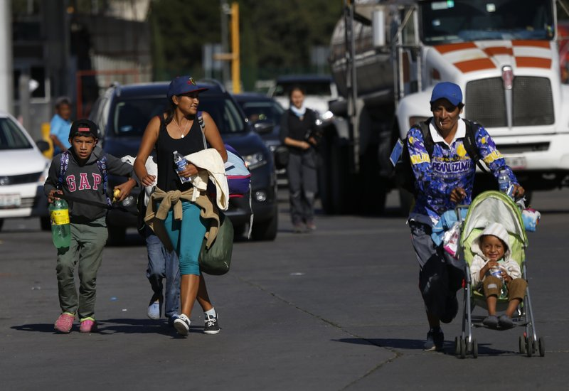 Central American migrants arrive to the City Mexico, as part of a thousands-strong caravan hoping to reach the U.S., Monday, Nov. 5, 2018. A big group of Central Americans pushed on toward Mexico City from a coastal state, planning to exit a part of the country that has long been treacherous for migrants seeking to get to the United States. (AP Photo/Marco Ugarte)