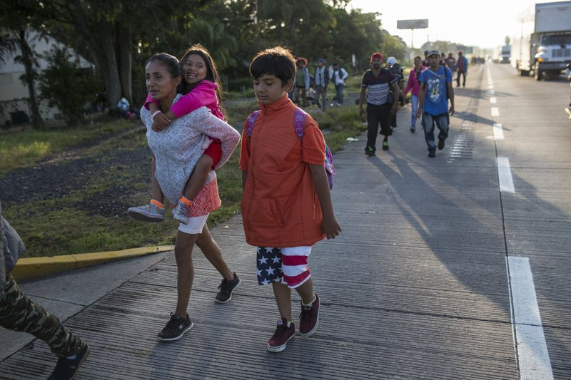 Central American migrants begin their morning trek, as part of a thousands-strong U.S.-bound caravan leaving Cordoba, Veracruz state, Mexico, Monday, Nov. 5, 2018. A big group of Central Americans pushed on toward Mexico City from a coastal state Monday, planning to exit a part of the country that has long been treacherous for migrants seeking to get to the United States. (AP Photo/Rodrigo Abd)