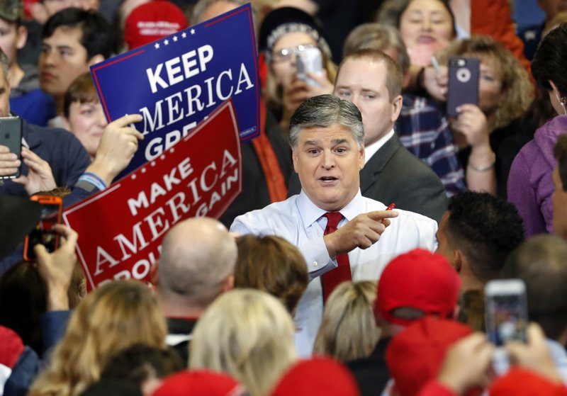Television personality Sean Hannity speaks to members of the audience while signing autographs before the start of a campaign rally Monday, Nov. 5, 2018, in Cape Girardeau, Mo., with President Donald Trump. (AP Photo/Jeff Roberson)