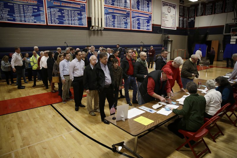 Voters line up to vote at a polling place in Doylestown, Pa., Tuesday, Nov. 6, 2018. (AP Photo/Matt Rourke)