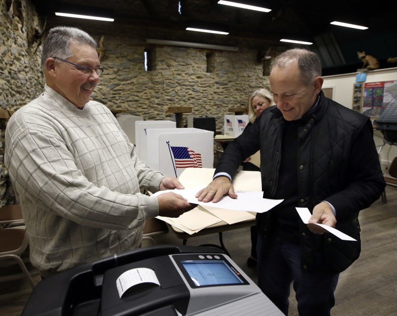 U.S. Representative Lloyd Smucker, R-Pa., tears off his receipt after casting his vote at the Lancaster County Environmental Center in Lancaster, Pa., Tuesday, Nov. 6, 2018. (AP Photo/Chris Knight)