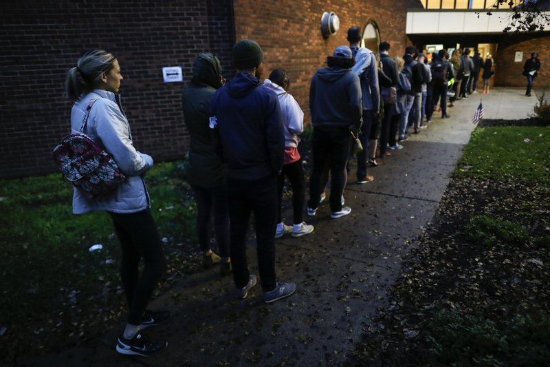 Voters arrive at the Tuttle Park Recreation Center polling location, Tuesday, Nov. 6, 2018, in Columbus, Ohio. Across the country, voters headed to the polls Tuesday in one of the most high-profile midterm elections in years. (AP Photo/John Minchillo)